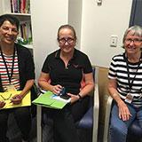 West Moreton Health social workers Sara Ellis, Catherine Stanbrook and Lynette Kindt during a team briefing in Townsville.